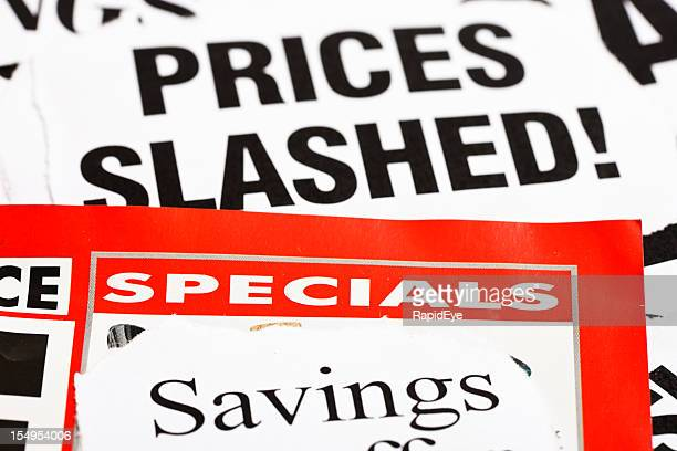 newspaper headlines announce price cuts - inexpensive stock photos and pictures