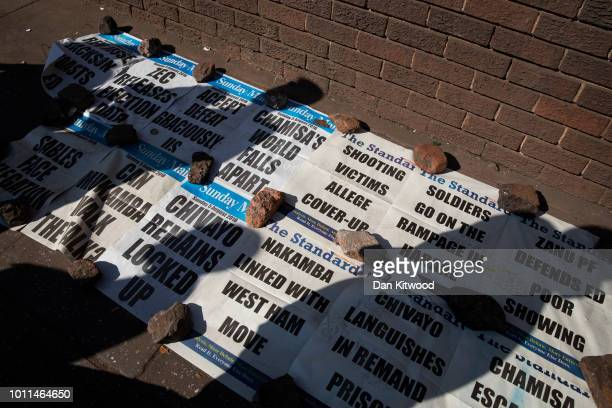 Newspaper headlines are seen on August 05 2018 in Harare Zimbabwe Zimbabwe Electoral Commission officials have announced the reelection of President...