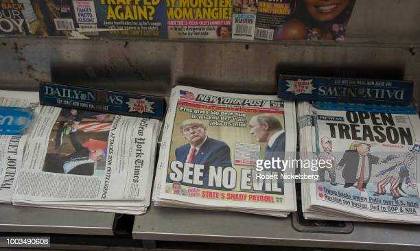 Newspaper headlines criticize US President Donald Trump's performance July 17 2018 during his Helsinki Finland meeting with Russian president...