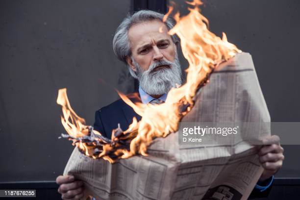 newspaper in fire - burning stock pictures, royalty-free photos & images