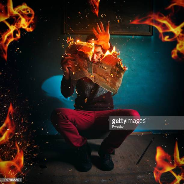 newspaper in fire - extremism stock pictures, royalty-free photos & images