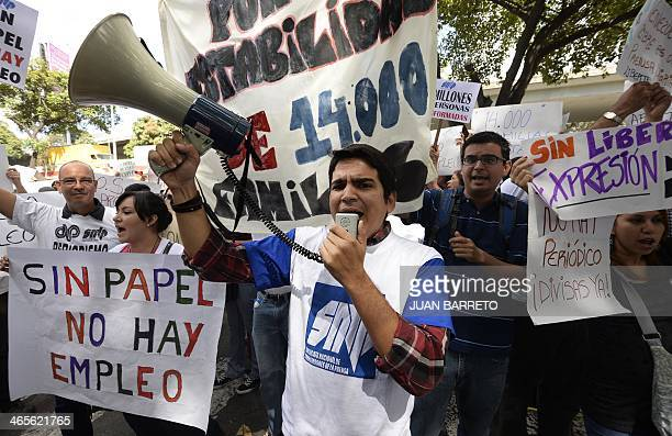 Newspaper journalists take part in a protest outside CADIVI headquarters in Caracas on January 28 2013 About 500 newspaper workers demanded to the...