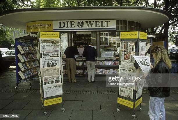 Newspaper kiosk with magazine racks