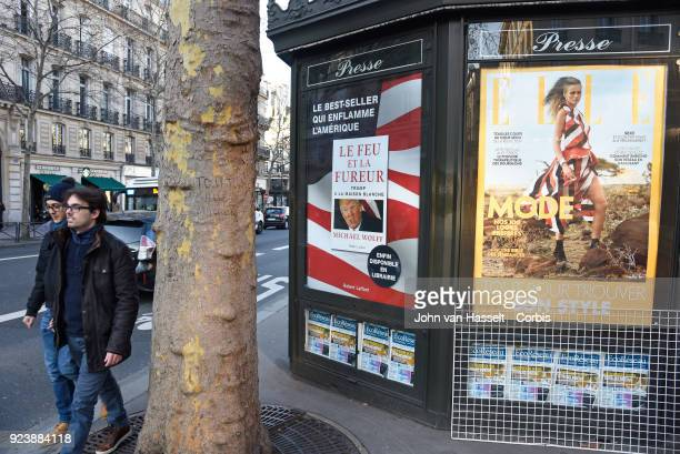 Newspaper kiosks advertise the French translation of Michael Wolff's book on Donald Trump Fire and Fury on February 23 2018 in Paris France The...
