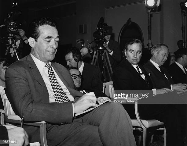 Newspaper magnates Robert Maxwell and Rupert Murdoch during voting on the News Of The World takeover