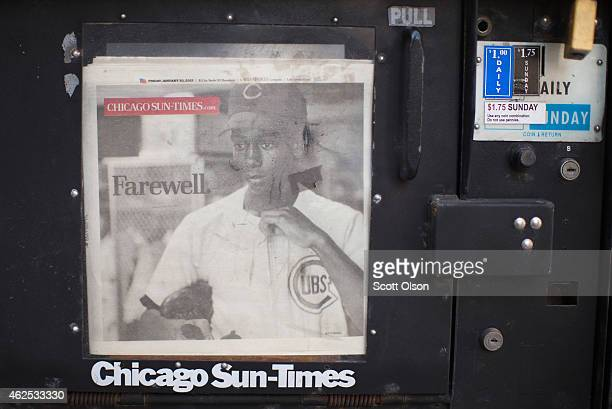 A newspaper mourning the passing of Ernie Banks is offered for sale in a vending machine outside the Fourth Presbyterian Church during a visitation...
