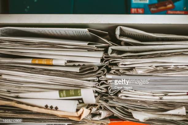 newspaper on cupboard for recycling - press conference stock pictures, royalty-free photos & images