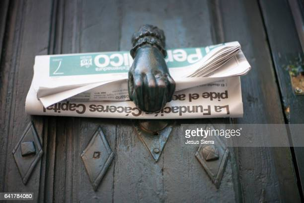Newspaper on the door of a house in Caceres