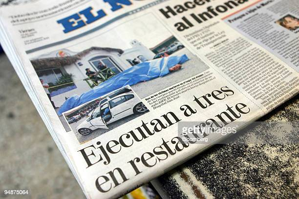 A newspaper photo showing the bodies of a victim of an apparent drugrelated killing is shown on a newstand in Monterrey Mexico Thursday June 9 2005...