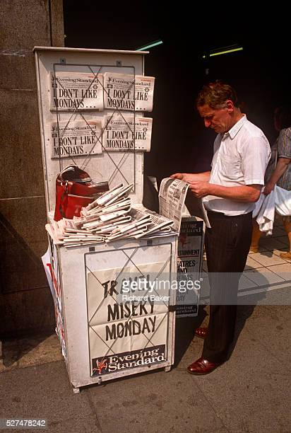 A Newspaper seller displays copies of the London tabloid aimed at commuters The Evening Standard on sale here at Monument underground station On this...
