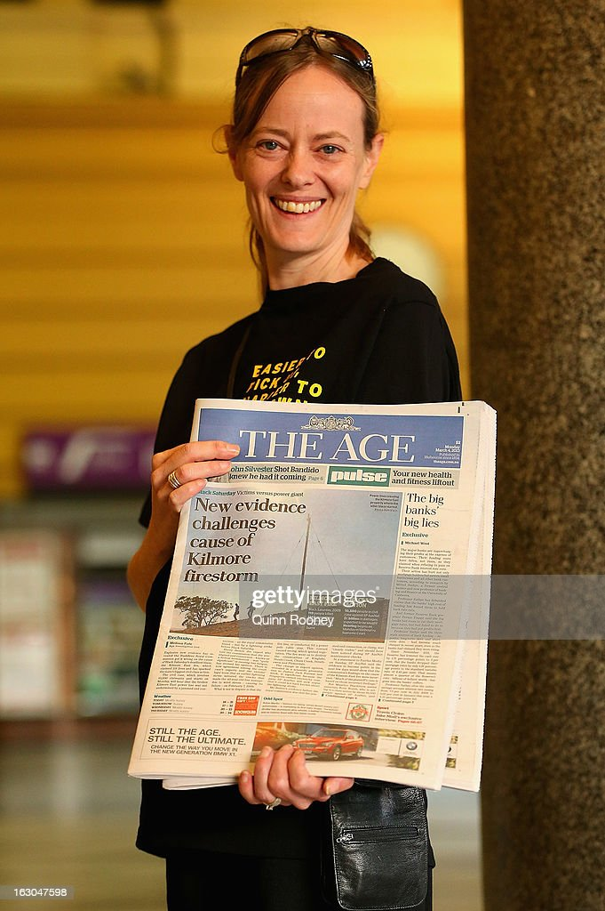 A newspaper seller displays The Age's first compact edition newspaper at Flinders Street Station on March 4, 2013 in Melbourne, Australia. The Sydney Morning Herald and The Melbourne Age published their first tabloid size editions today, after 180 years of producing weekday broadsheets.