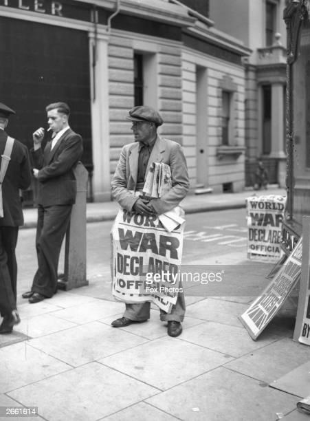 Newspaper seller in England announces 'World War Declared Official'.