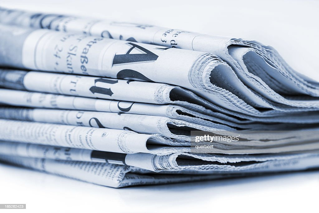Newspaper stack (blue toned) : Stock Photo