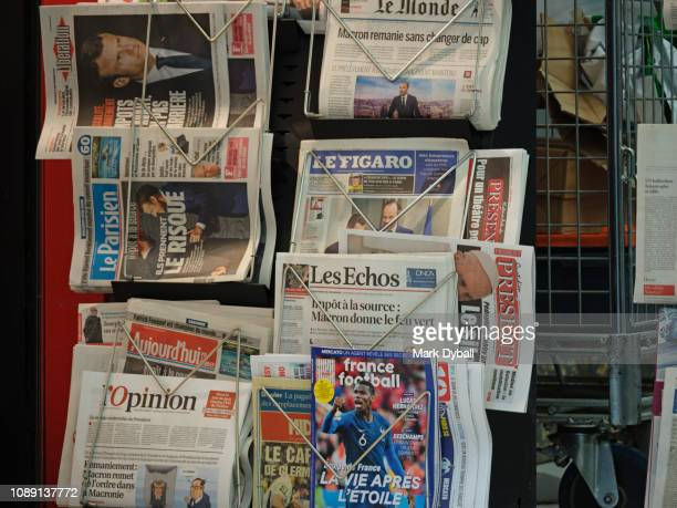 newspaper stand in gare du nord station, paris, france - mark dyball stock photos and pictures