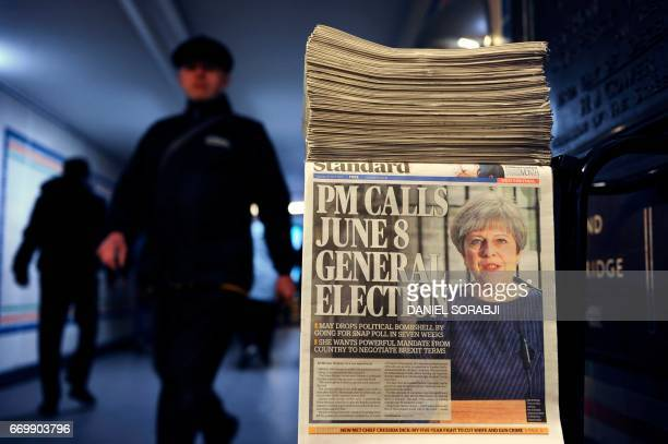A newspaper stand shows a copy of today's Evening Standard with the front page story relating to British Prime Minister Theresa May's call for a snap...