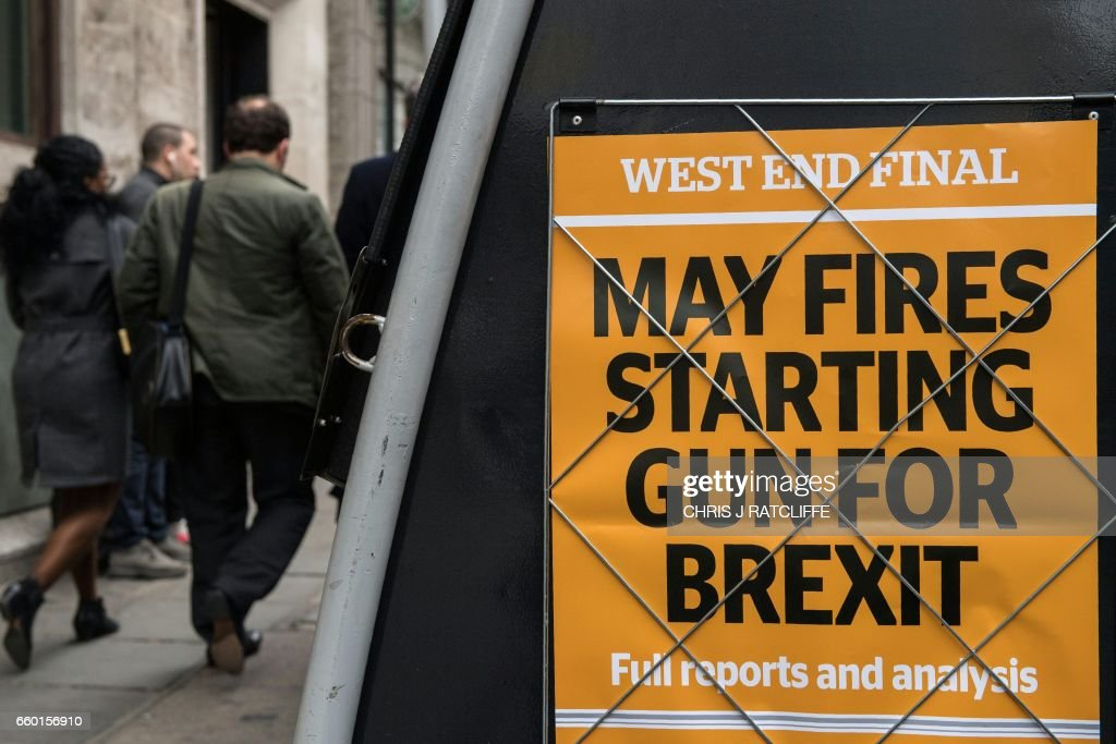 A newspaper stand shows an advert for today's Evening Standard newspaper, leading with the story relating to British Prime Minister Theresa May's triggering of Article 50 of the Lisbon Treaty to begin the process of Britain's withdrawal from the European Union (EU), in London on March 29, 2017. Britain launched the process to leave the European Union Wednesday, saying there was 'no turning back' from the historic move that has split the country and thrown the bloc's future into question. /