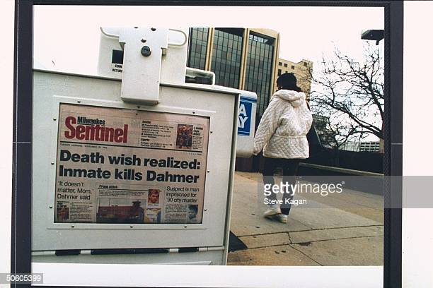 Newspaper vending machine sporting the MILWAUKEE SENTINEL whose headline reads DEATH WISH REALIZED INMATE KILLS DAHMER