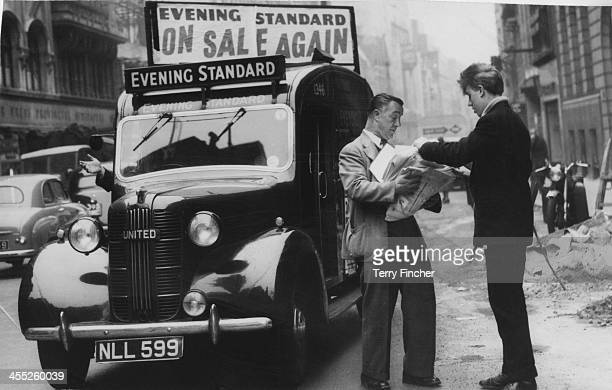 Newspaper vendor receives copies of the Evening Standard after the Fleet Street strike, London, 21st April 1955.