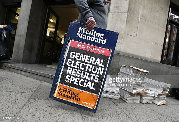 A newspaper vendor sets out his stall in central London on May 8 a day after the British general election British Prime Minister David Cameron's...