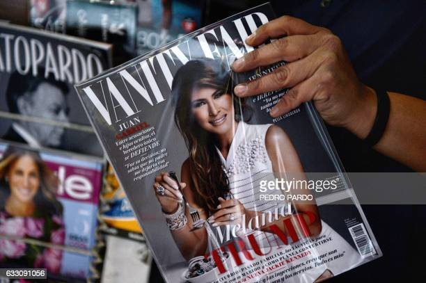 A newspaper vendor shows the February 2017 issue of the Mexican edition of Vanity Fair with the US first lady Melania Trump in the cover at their...