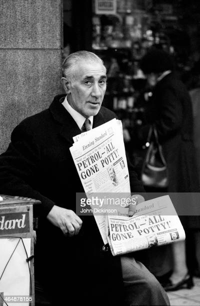Newspaper vendor with copies of the Evening Standard on the day petrol reached the price of £1.00 per gallon.