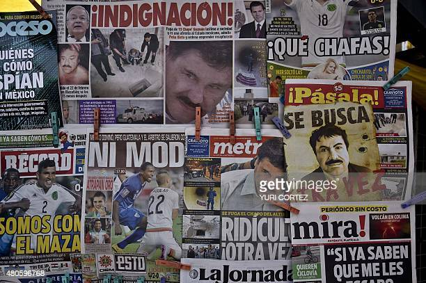 A newspaper with a poster of Mexican drug lord Joaquin El Chapo Guzman reading Wanted Again is displayed at a newsstand in one Mexico City's major...