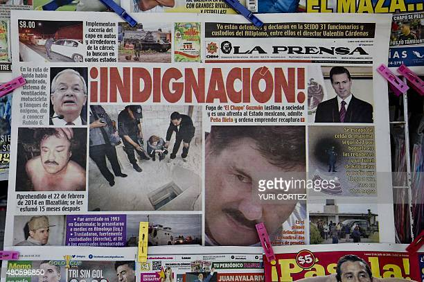 A newspaper with an image of Mexican drug lord Joaquin El Chapo Guzman is displayed at a newsstand in one Mexico City's major bus terminals on July...