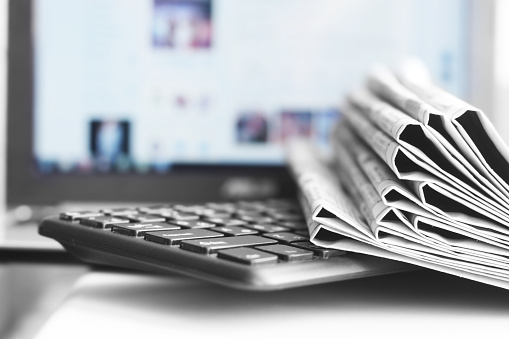 Newspapers and Laptop 1140728159