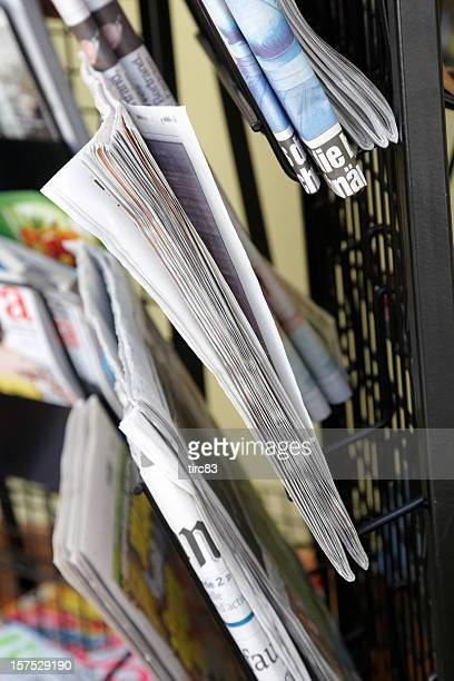 newspapers and magazines on rack - news stand stock pictures, royalty-free photos & images