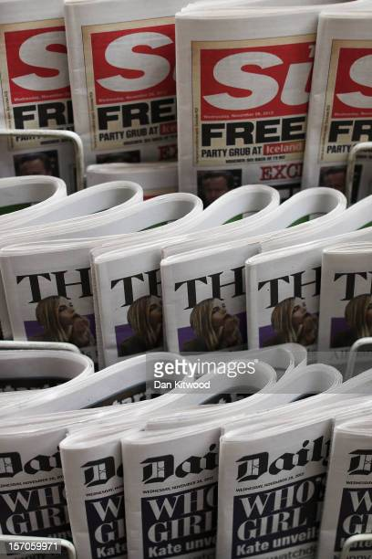 Newspapers are displayed on a stand outside a newsagent on November 28 2012 in London England The findings of the Leveson Inquiry which focused on...