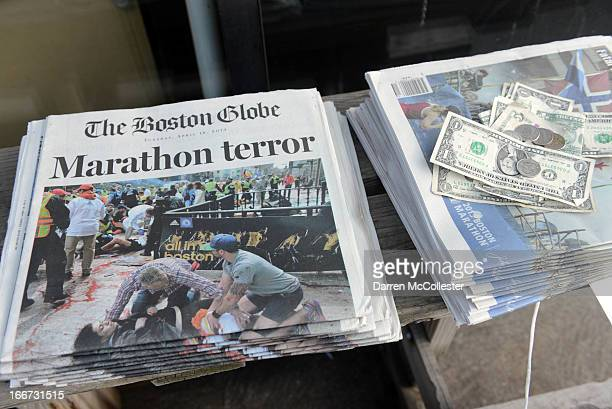 Newspapers are on sale at a stand on Newbury Street on April 16 2013 in Boston Massachusetts Security is especially tight in the city of Boston after...