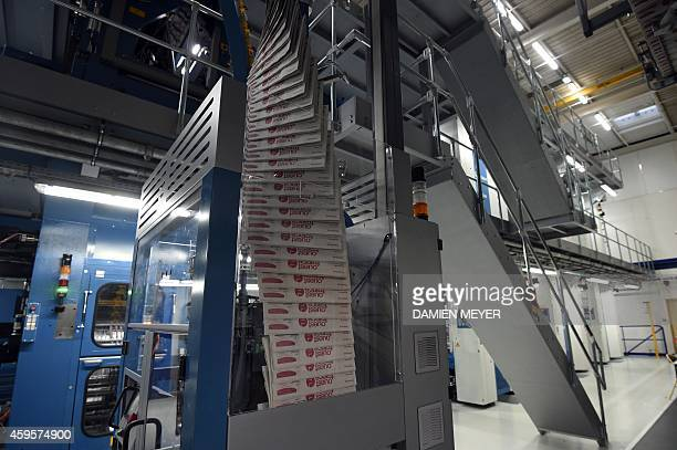 Newspapers are produced on the new rotary printing press at French media OuestFrance headquarters in the western city of Rennes on November 24 2014...