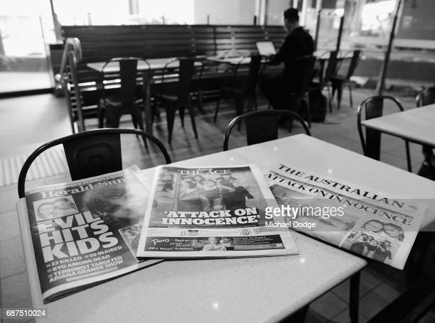 This image has been converted to black and white Newspapers are seen with headlines and stories covering the Manchester Bombing on May 24 2017 in...