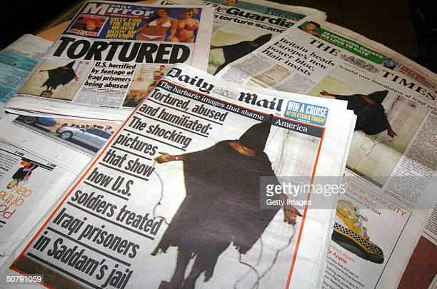 Newspapers display pictures of Iraqi prisoners being tortured and humiliated by US military personnel May 1 2004 in London