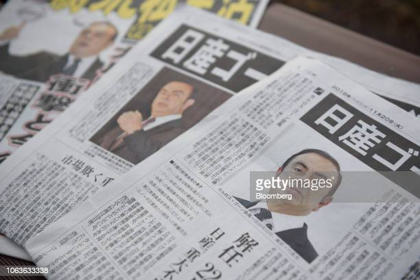 Newspapers feature articles on Carlos Ghosn chairman of the alliance between Renault SA Nissan Motor Co and Mitsubishi Motors Corp in Yokohama...