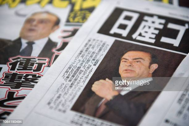 Newspapers featuring articles on Carlos Ghosn chairman of the alliance between Renault SA Nissan Motor Co and Mitsubishi Motors Corp are displayed in...