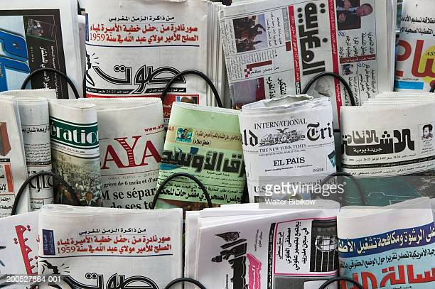 newspapers for sale in rack, close up - arabic script stock pictures, royalty-free photos & images
