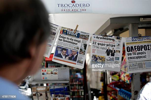 Newspapers hang from a kiosk in Thessaloniki Greece on Tuesday June 23 2015 The possible deal got a resounding endorsement from Greece's markets with...