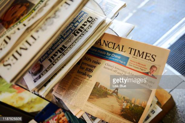 newspapers in a kiosk, london - england. - news stand stock pictures, royalty-free photos & images