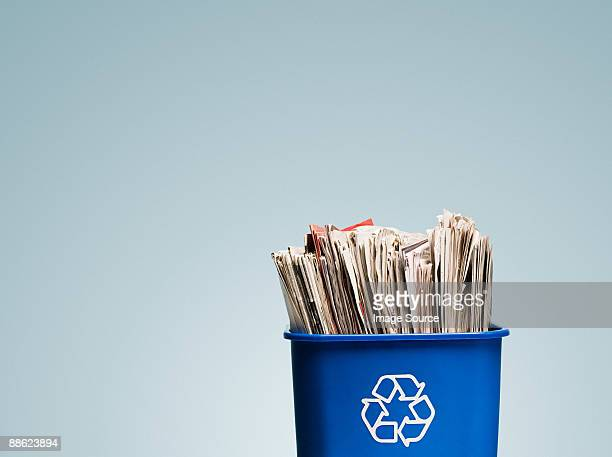 newspapers in a recycling bin - recycling bin stock pictures, royalty-free photos & images
