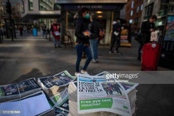 Newspapers show a headline that London is the centre of the UK virus outbreak at St Pauls station on March 16, 2020 in London, England. The UK's...