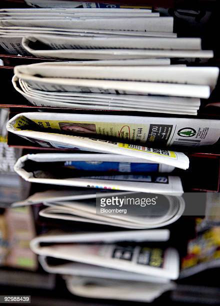 Newspapers sit on display at a newsstand in New York US on Wednesday Nov 11 2009 US newspaper circulation declines steepened in the six months...