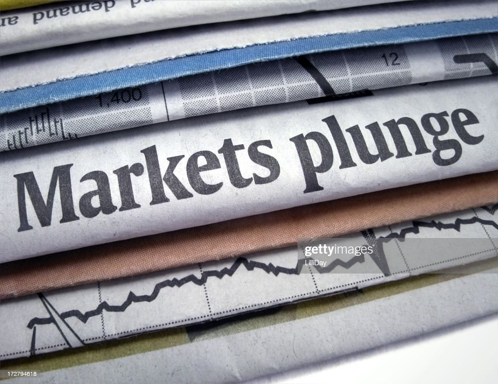Newspapers stacked with Markets Plunge headline : Stock Photo