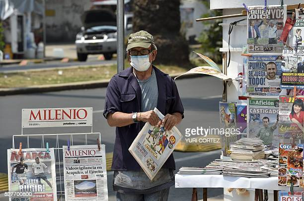 A newspapers vendor wears a surgical mask in smogcovered Mexico City on May 3 2016 Mexico City officials issued a new air pollution alert yesterday...