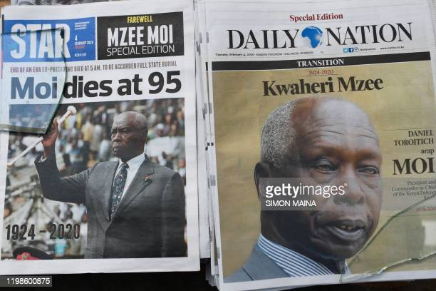Newspapers with the headline on the death of former Kenya's president Daniel Arap Moi are displayed in Nairobi on February 4 2020