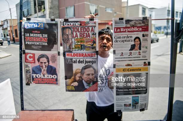 TOPSHOT Newspapers with the portrait of former Peruvian President Alejandro Toledo on their front pages are displayed for sale in Lima on February 10...