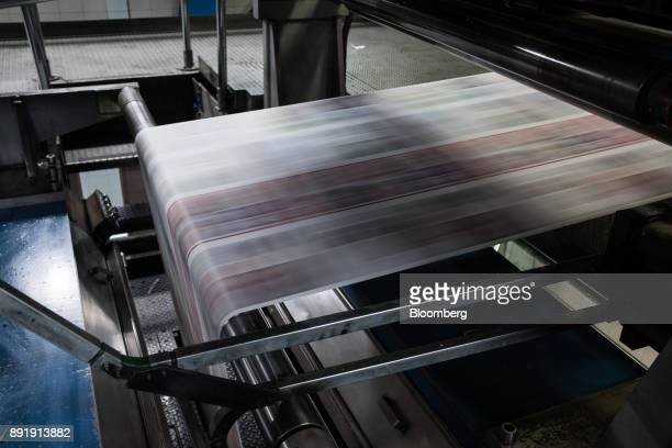 Newsprint passes through a rotary press at the El Tiempo SA printing facility in Bogota Colombia on Friday Dec 1 2017 Founded in 1911 El Tiempo is a...