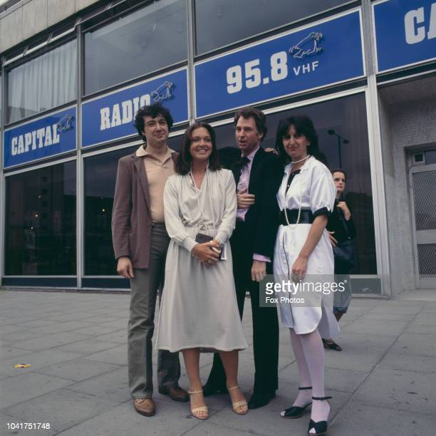 ITN newsreader Anna Ford outside the Capital Radio headquarters in London England with presenter Adam Singer managing director John Doff and producer...