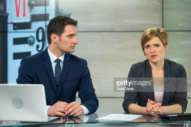 newsreader couple in television studio - newscaster stock pictures, royalty-free photos & images