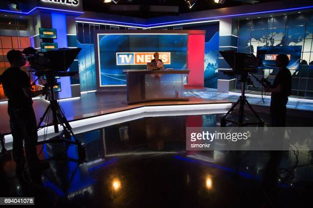 newsreader filming in press room - journalist stock pictures, royalty-free photos & images
